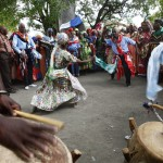Haitians dance under a sacred ceibo tree called Lisa as they participate in a Voodoo ritual on the third day of the annual week-long gathering in the Souvenance community, April 1, 2013. Hundreds of Haitians participate in the ceremonies which begin the Saturday before Easter in Souvenance, where descendants of the people of Dahomey, a former kingdom in what is now present-day Benin, show their devotion to their ancestors and various lwa, or spirits, This third day of ceremonies represents their journey back to Africa. Picture taken April 1, 2013.     REUTERS/Marie Arago (HAITI  - Tags: SOCIETY RELIGION)